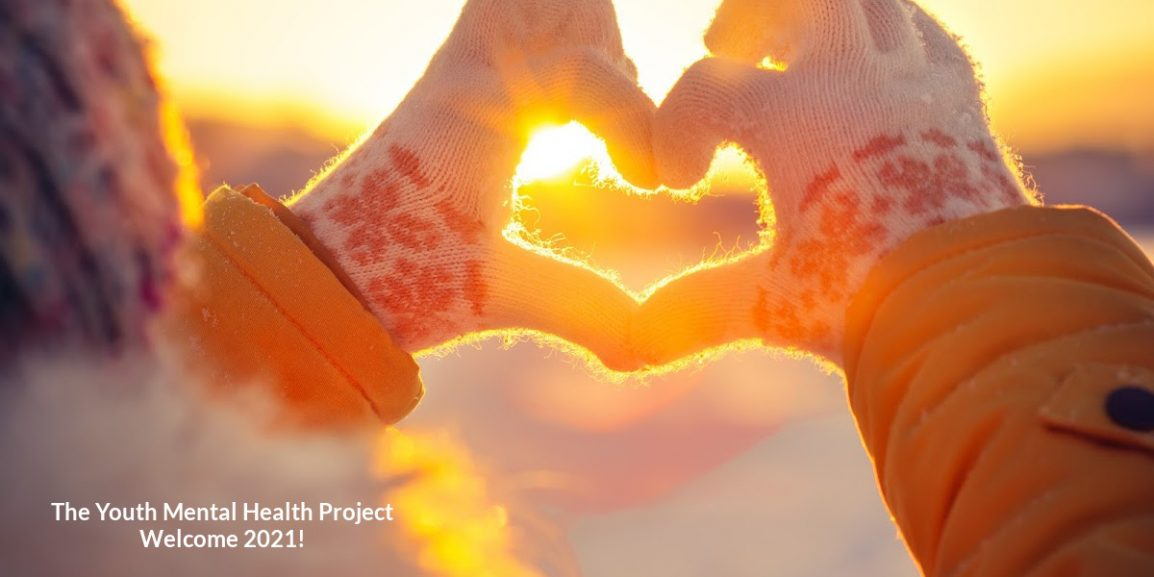 Welcome 2020 hands in winter gloves Heart symbol with sunset